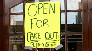 "A restaurant sign reads ""Open For Take-Out"" during the COVID-19 pandemic."