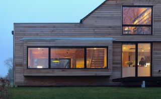 Contemporary new home clad in untreated cedar