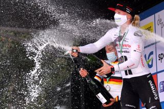DE PANNE BELGIUM OCTOBER 20 Podium Lisa Brennauer of Germany and Ceratizit Wnt Pro Cycling Team Lorena Wiebes of The Netherlands and Team Sunweb Celebration Champagne Mask Covid safety measures during the 3rd Driedaagse Brugge De Panne 2020 Women Classic a 1563km race from Brugge to De Panne AG3daagse on October 20 2020 in De Panne Belgium Photo by Luc ClaessenGetty Images