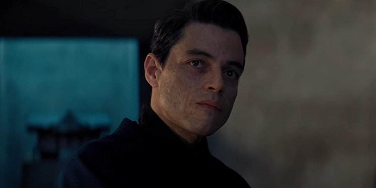 No Time To Die Rami Malek sternly looks at James Bond