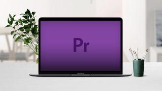 Adobe Premiere Pro logo on a 13 inch MacBook Air on a desk