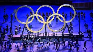 Performers dance during the 2020 Tokyo Summer Olympic Games opening ceremony at the Olympic Stadium in Tokyo, Japan.