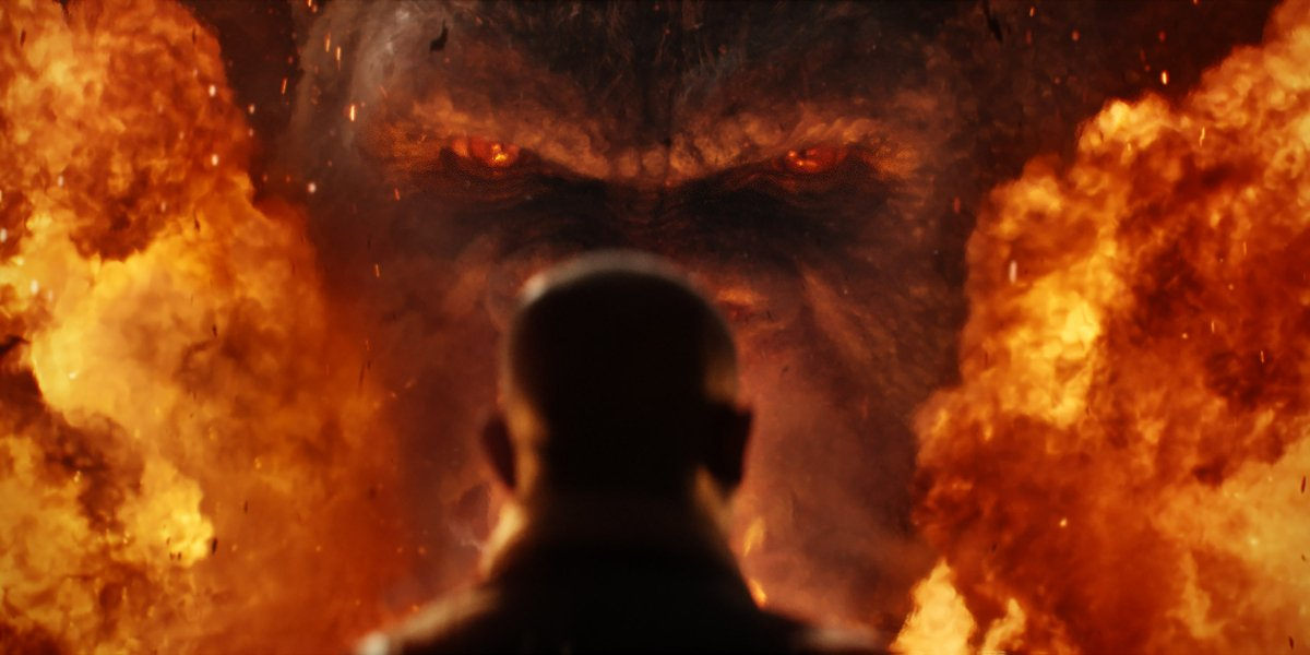 Kong faces down Samuel L. Jackson in the fire, in Kong: Skull Island.