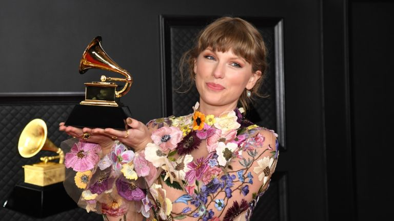 aylor Swift, winner of Album of the Year for 'Folklore', poses in the media room during the 63rd Annual GRAMMY Awards