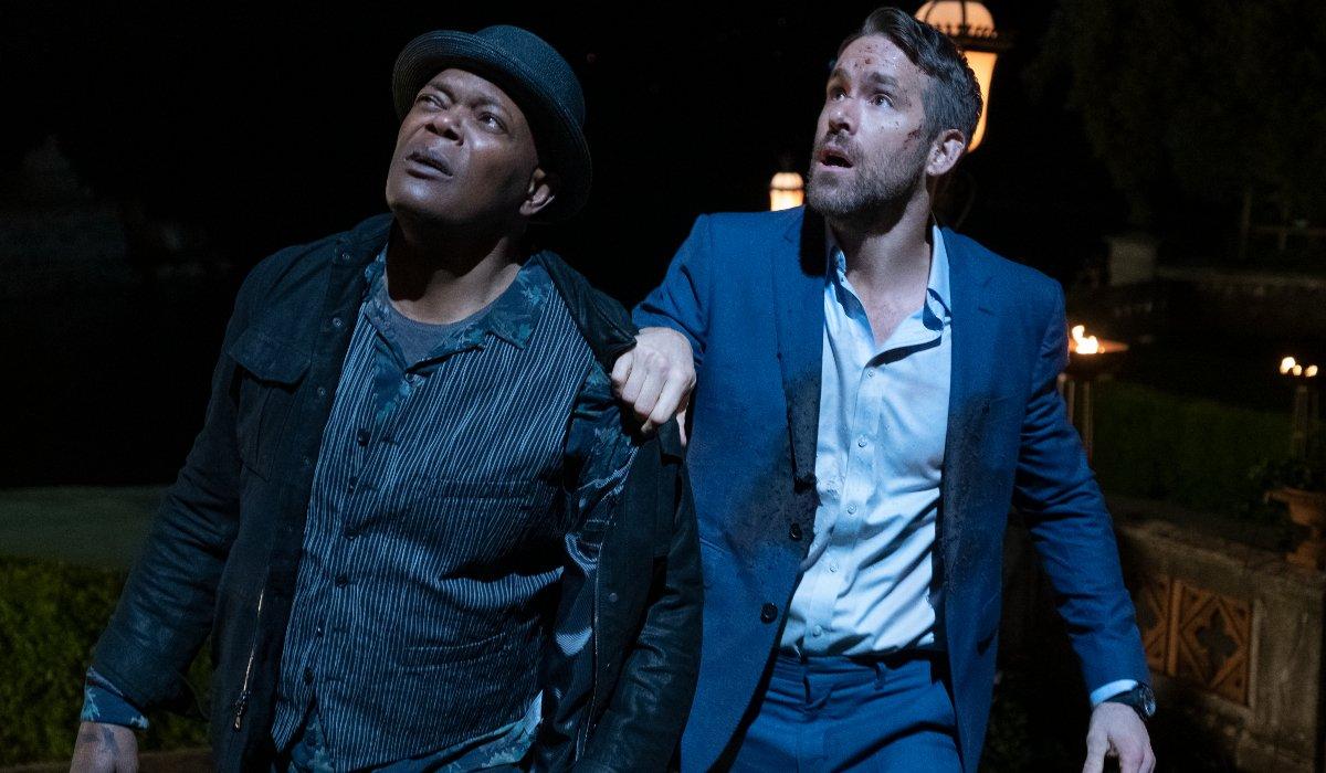 Samuel L Jackson and Ryan Reynolds look up in disbelief in The Hitman's Wife's Bodyguard.