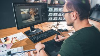 digital artist working on a computer