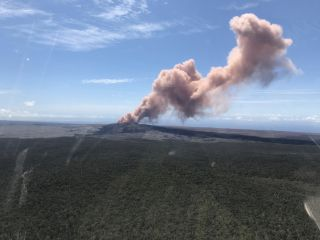 A plume of ash shoots into the air after a magnitude-5.0 earthquake shakes Hawaii's Kilauea south of the Pu'u 'Ō'ō crater floor on Thursday (May 3).