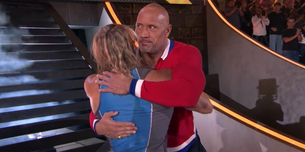 Dwayne Johnson hugging contestant in The Titan Games screenshot