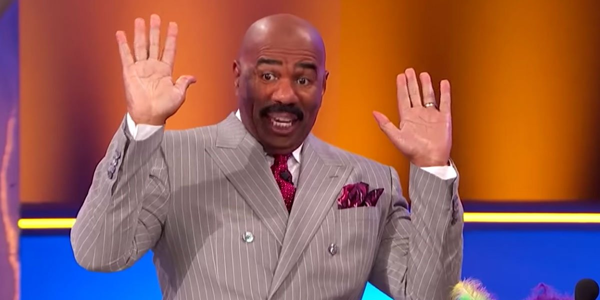 Steve Harvey excited on Family Feud. Good look at his mustache.