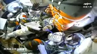 China's three Shenzhou 12 astronauts inside their spacecraft during their launch to space.