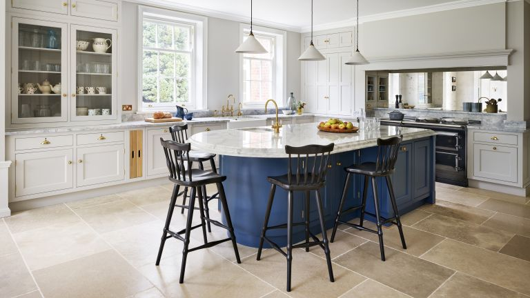 white kitchen with blue kitchen island by Martin Moore