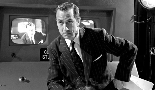 Good Night, and Good Luck. Edward R. Murrow sits on a console, in a smoky newsroom