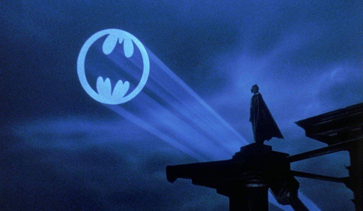 Batman Michael Keaton looks out at the Bat Signal