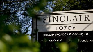 Signage stands outside the Sinclair Broadcast Group Inc. headquarters in Cockeysville, Maryland, U.S., on Friday, Aug. 10, 2018