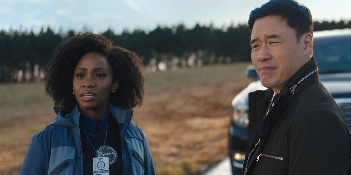 Teyonah Parris on the left, Randall Park on the right