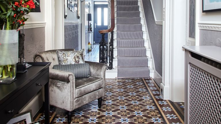 Mosaic flooring in a hallway