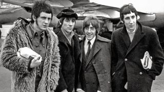 A shot of the who outside a plane