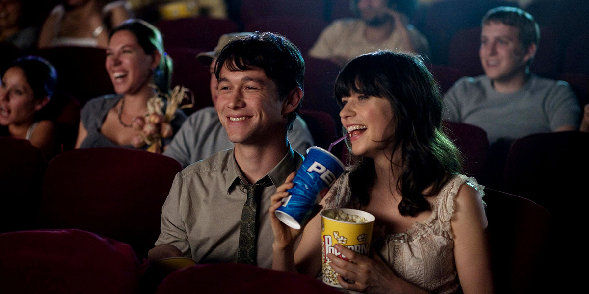 A couple enjoying the movies in 500 Days of Summer