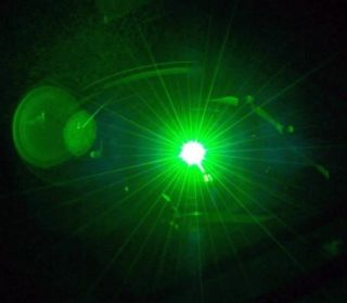"""In a new study scientists found a way to make laser light incredibly """"pure"""" by ensuring that it remains steadily at almost the same wavelength. (Note: the image is not the laser in question)."""