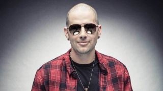A photograph of M Shadows smiling