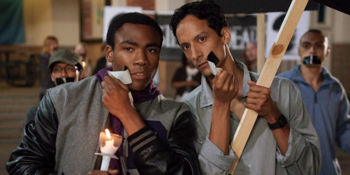 Troy and Abed at a vigil in Community.