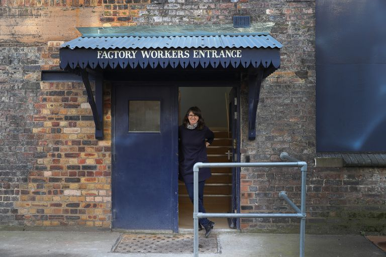 Emma Bridgewater standing at factory entrance