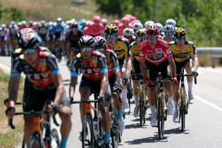 ESPINOSA DE LOS MONTEROS SPAIN AUGUST 16 LR Nathan Van Hooydonck of Belgium Primoz Roglic of Slovenia red leader jersey and Steven Kruijswijk of Netherlands and Team Jumbo Visma compete during the 76th Tour of Spain 2021 Stage 3 a 2028km stage from Santo Domingo de Silos to Espinosa de los Monteros Picn Blanco 1485m lavuelta LaVuelta21 CapitalMundialdelCiclismo on August 16 2021 in Espinosa de los Monteros Spain Photo by Gonzalo Arroyo MorenoGetty Images