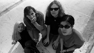 A picture of Darcy Wretzsky, Jimmy Chamberlin, Billy Corgan and James Iha of the Smashing Pumpkins, taken in 1992