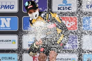 Dutch Marianne Vos celebrates on the podium with champagne after winning the womens edition of the GentWevelgem In Flanders Fields 2475 kilometers road cycling race from Ypers to Wevelgem on March 28 2021 Belgium OUT Photo by DAVID STOCKMAN various sources AFP Belgium OUT Photo by DAVID STOCKMANBelgaAFP via Getty Images