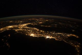 Nighttime panorama of Italy from the International Space Station.