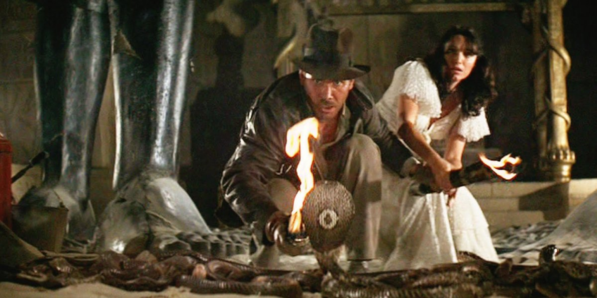 Harrison Ford and Karen Allen with snakes in Raiders of the Lost Ark