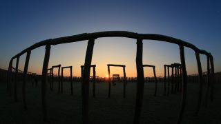 """The sun rises behind the reconstructed """"Ringheiligtum Pömmelte"""" in eastern Germany, on Dec. 21, 2016, the winter solstice, which is the shortest day of the year."""