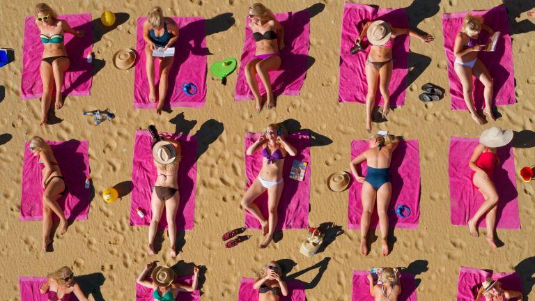 Aerial shot of women sunbathing on a beach