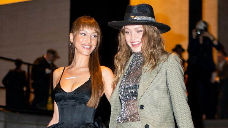 Bella Hadid (L) and Gigi Hadid attend Marc Jacobs and Char DeFrancesco's wedding reception at The Grill in Midtown on April 07, 2019 in New York City.