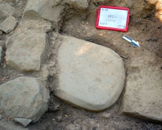 A 500-pound stone tablet found in the foundation of an Etruscan temple at the Poggio Colla site in Tuscany.
