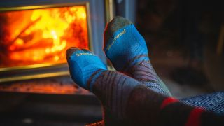 Smartwool socks by a toasty fire