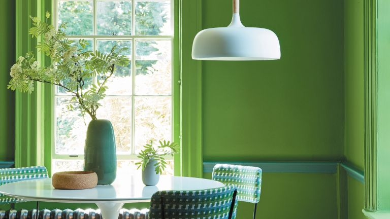 Green color drenched kitchen and dining room by Little Greene