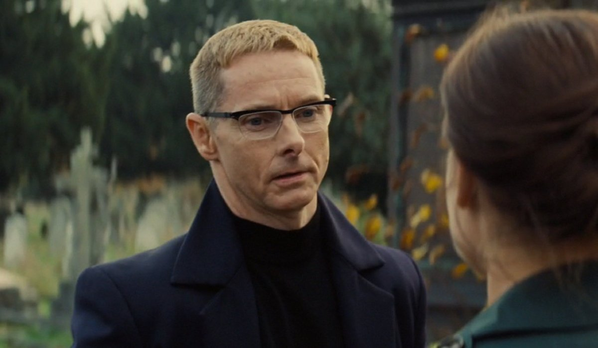 Sean Harris talking to Rebecca Ferguson in a graveyard in Mission: Impossible - Rogue Nation
