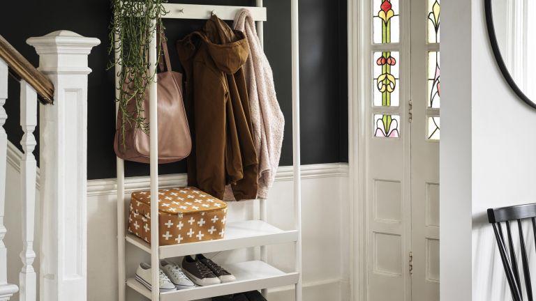 Small hallway ideas: White tallboy storage unit in hallway with stain glassed window doors by Habitat