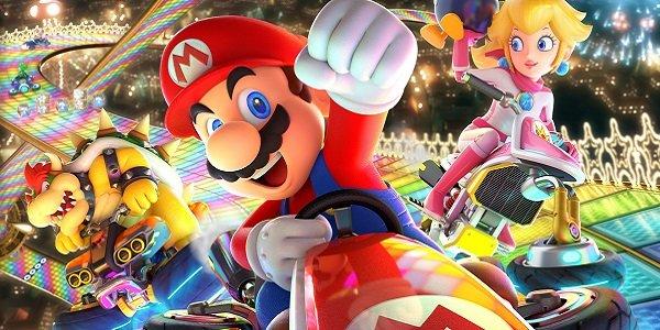 Mario Kart characters race on Rainbow Road.