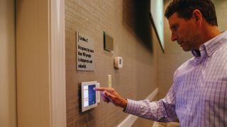 Control panels allow users to easily manage audio, projection, and other AV systems at the Hilton Greenville.
