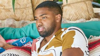Bachelor in Paradise Ivan Hall on a daybed