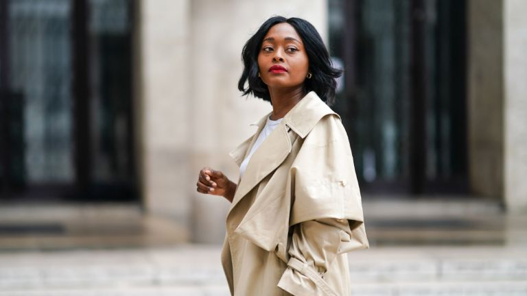 how to wear a trench coat: woman wearing a trench coat
