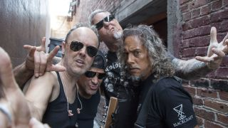 A photograph of Metallica mucking about outside a record store