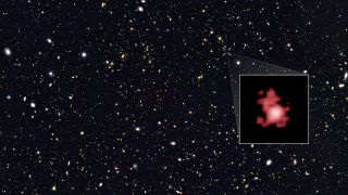 The galaxy GN-z11, which scientists think could be the farthest and oldest galaxy every observed, superimposed on an image from the COODS-North survey.
