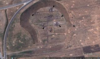 Military tanks can now be seen inside bunkers carved into the ancient mound called Tell Qarqur in Syria. The mound was once the site of an archaeological expedition.