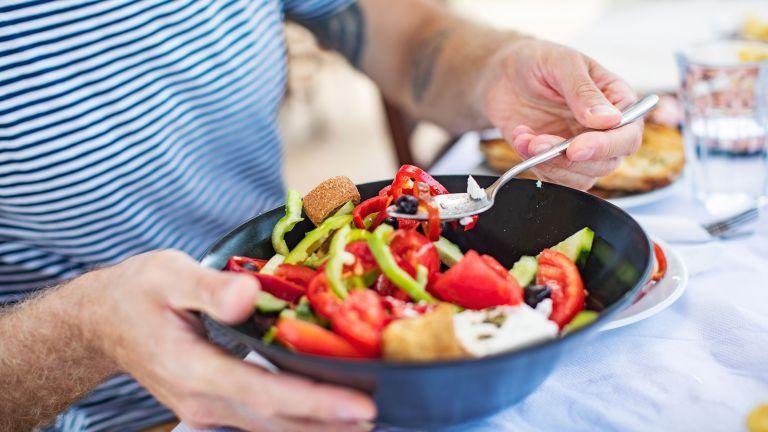 Man eating a healthy salad bowl