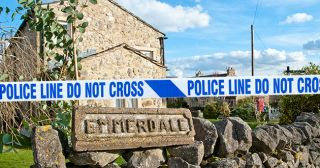 Emmerdale police tape across the village.
