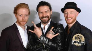 a portrait of biffy clyro smiling