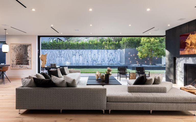 living room in modern farmhouse by Jae Omar in California
